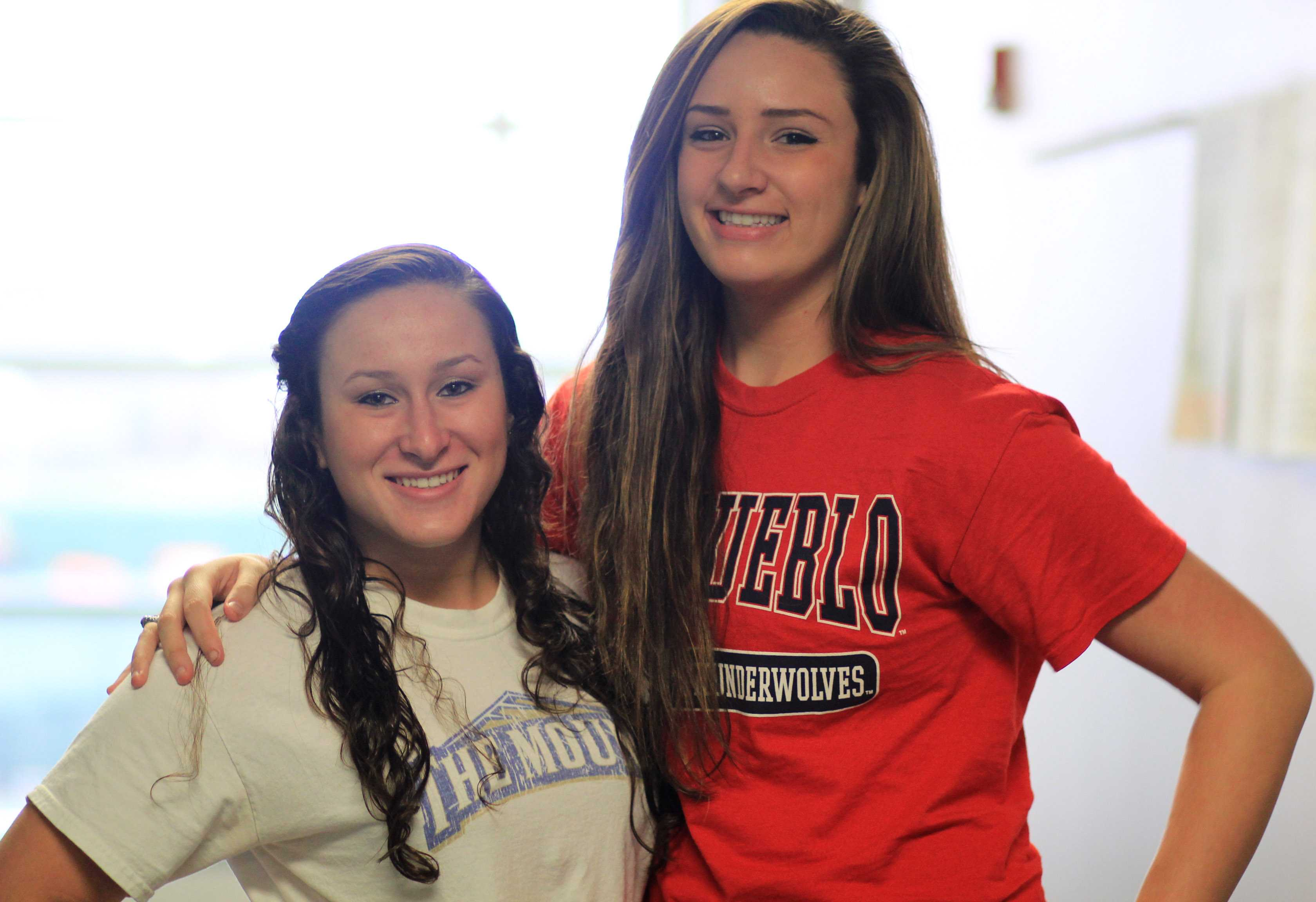 Sisters Angela and Amanda Moore outside of their third period class in their chosen college gear.