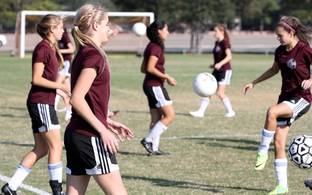 Varsity+girls+soccer+practicing+for+the+first+game+of+the+season+against+Lamar+Jan.+13%2C+2012