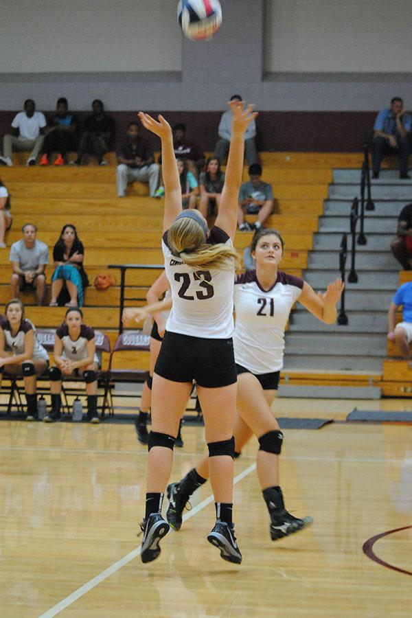 Sophomore+Audrey+Parker+sets+the+ball+for+sophomore+Madison+Bayer+in+the+JV+match+against+Cy-Fair+Aug.+12.