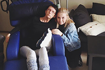 Junior Hannah Holvik visits her mother, Heidi Holvik, at a rehabilitation center in Drammen, Norway. Her mother has been fighting Huntington's disease for nearly two decades.