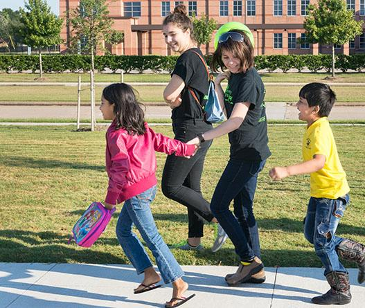 Barsha Darjee and Swastik Sanyasi excitedly make their way towards the Robert Shaw Center upon their arrival. Aided by CRyptonite members Maddison Willmott and Sophie van Dijke, the children are ready to learn more about science concepts such as force and air pressure as a part of their field trip sponsored by the Houston chapter of Sewa.