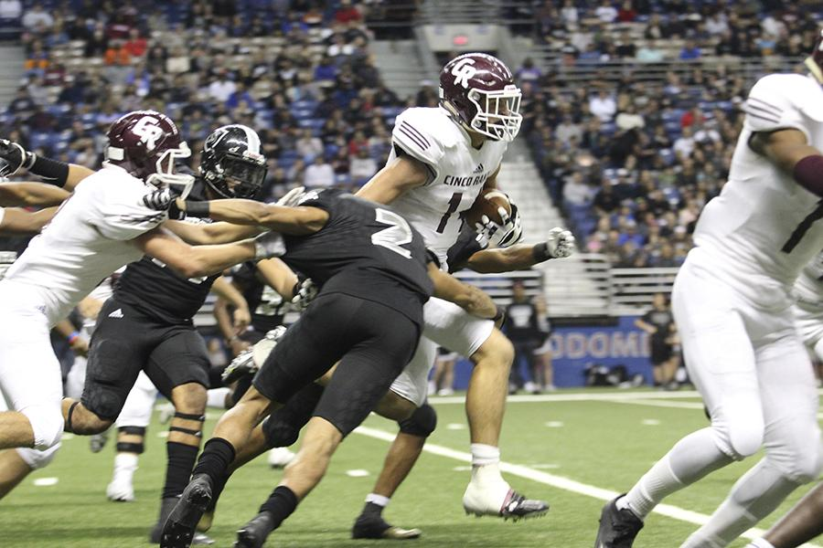 Brant Kuithe breaks through Cibolo Steele tacklers at the 6A Div II State Semi-final Saturday night in San Antonio.