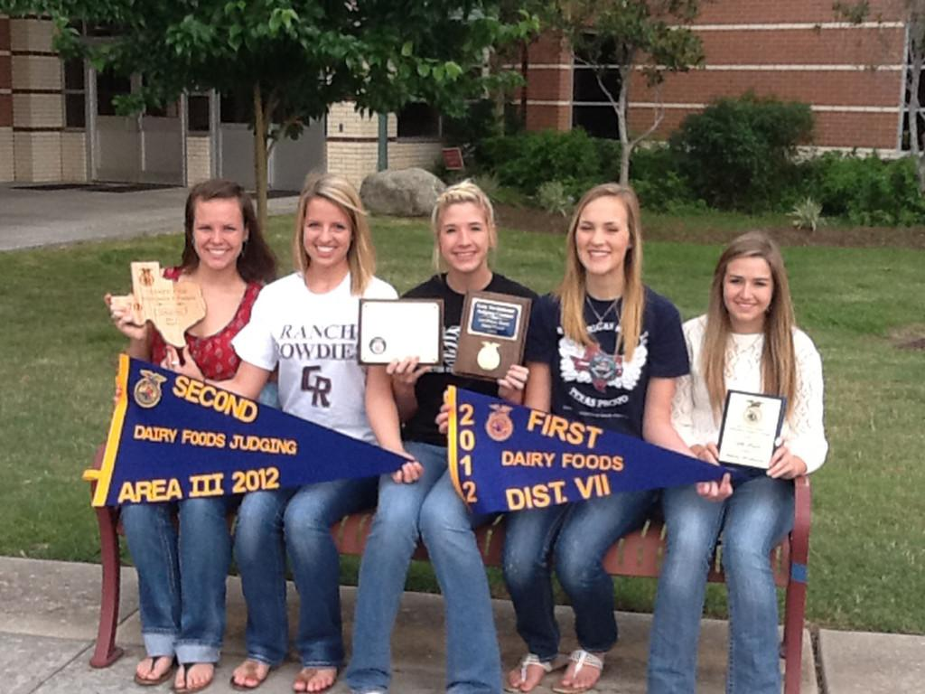 The FFA milk quality team gathers together with the awards they won throughout the competition season. Pictured, left to right: senior Savannah Tarpey, sophomore Bronwyn Sinquefield, senior Taylor Benyak, sophomore Allison Steed, and sophomore Megan McRory.