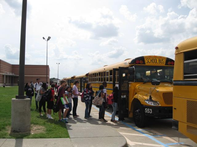 Students line up for the buses after school ends. Many bus routes were cut at the start of this school year, causing slower traffic before and after school.