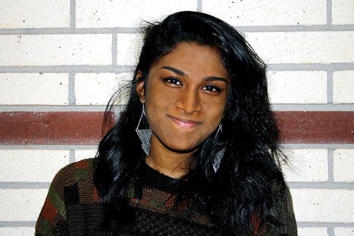 Behind Naimah Urfi's smile