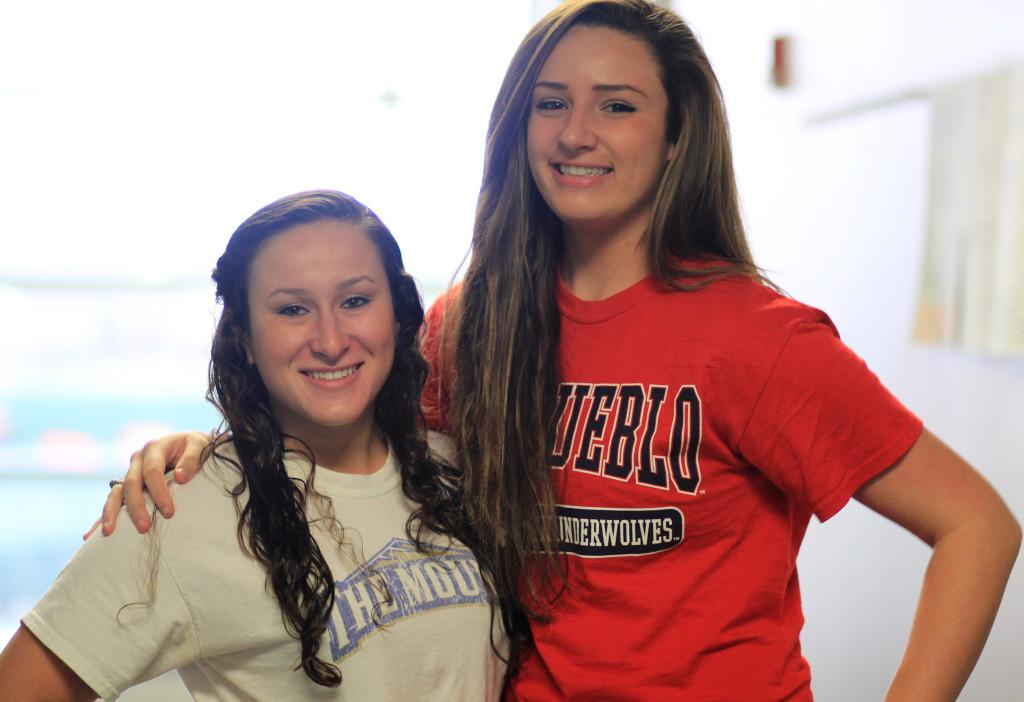 Sisters+Angela+and+Amanda+Moore+outside+of+their+third+period+class+in+their+chosen+college+gear.+