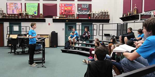 Senior Austin Crosby leads the student Christian group REACH at a weekly Friday meeting.  The student-led organization holds prayer and worship gatherings every Friday morning at 7 am in the choir room.