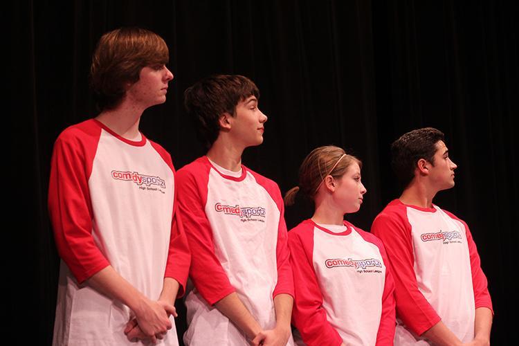 Left to right: Senior Braden Baumbach, sophomore James Yoder, junior Rebecca Russell and junior Kameron Knott await the beginning of the match.