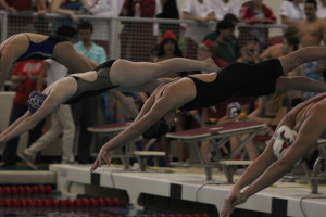 Varsity swim sweeps competition at districts