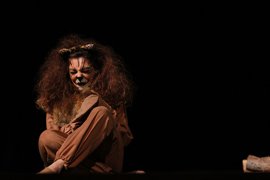 Senior+Madison+Hill++cowers+as+the+Cowardly+Lion+in+the+elementary+school+performance+of+The+Wizard+of+Oz+on+Wednesday%2C+October+9th.++