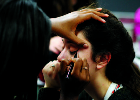 Junior Courtney Morris applies makeup to senior Julia Riffle on one of the club's events, Cosmetology Day.