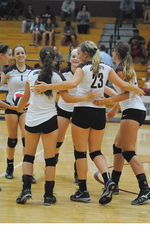 The JV squad celebrates after scoring a point.