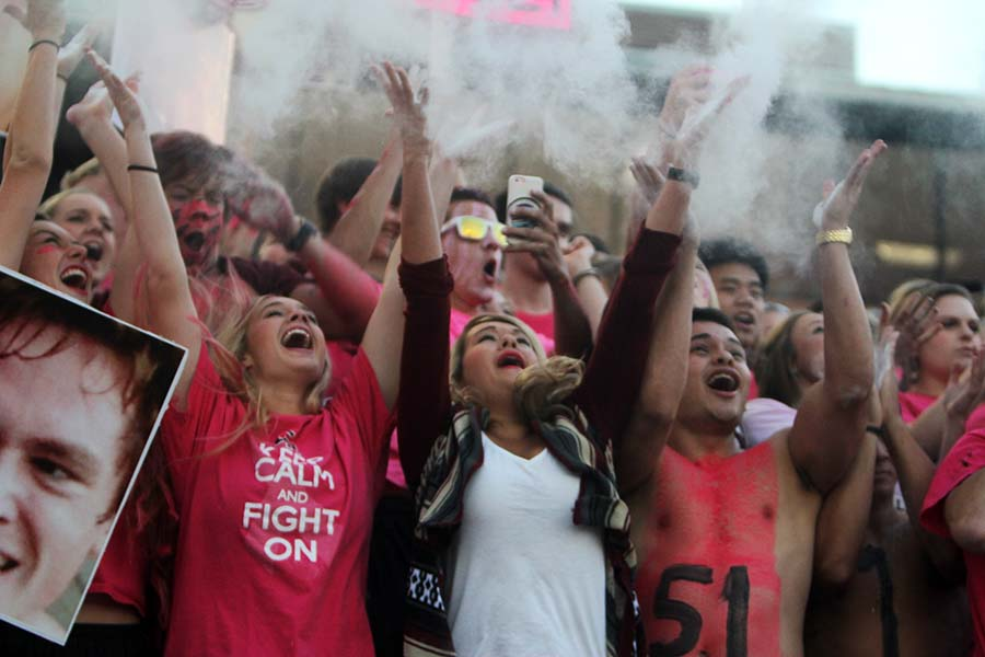 Cinco Ranch cougar fans throw baby powder up in the air to mimic a smoke effect.