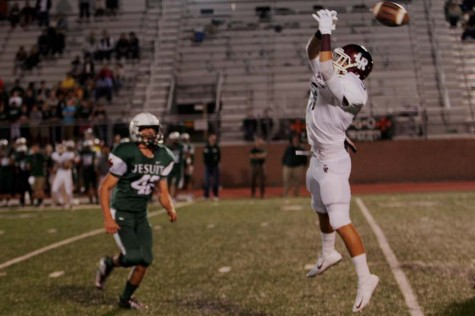 Senior Matt Hutson lunges to catch what became an incomplete pass.