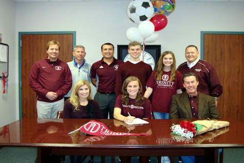 Senior Madee Gallagher along with family and current and future coaches signs with Trinity University.