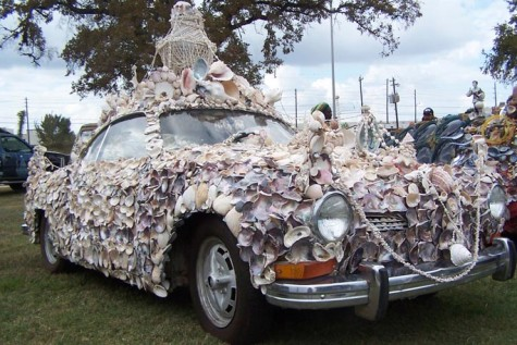Covered in seashells, 'MiShell', a 1973 VW Karmann Ghia, by artist Kathaman, is one of the many pieces of remodeled cars exhibited at the Art Car Museum