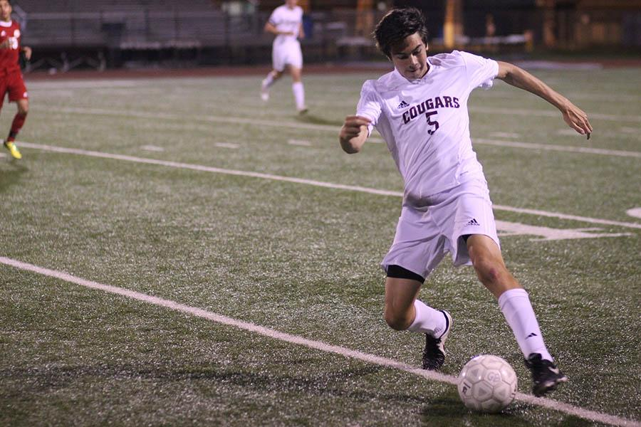 Sophomore Nic Fielden reaches for the ball during a district match against Katy on March 20.