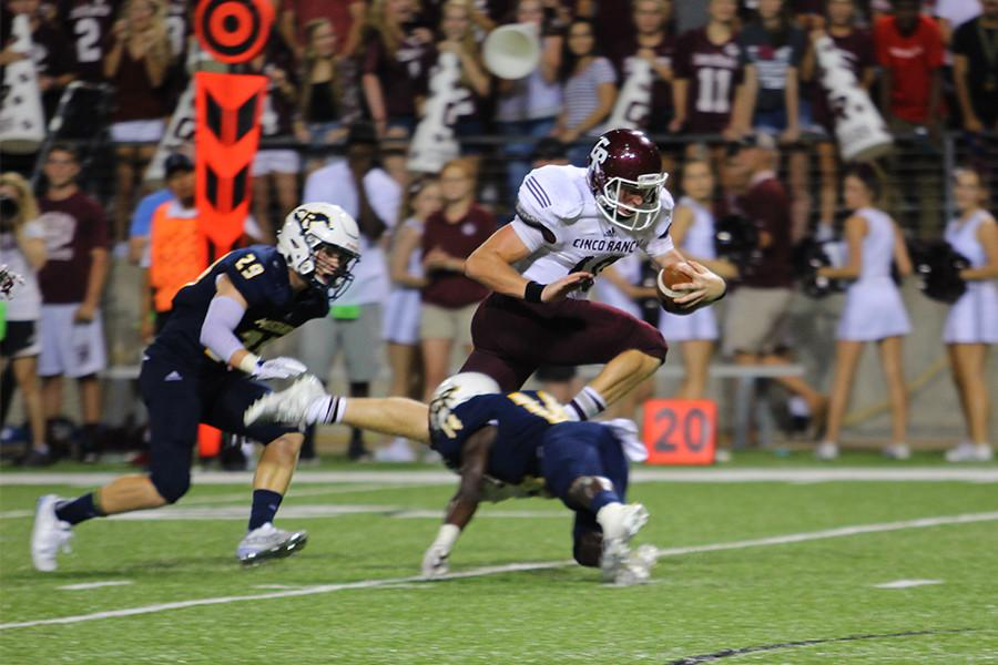 Senior QB Russell Morrison rushes the ball towards the Cy-Ranch end zone from the 15-yard line.