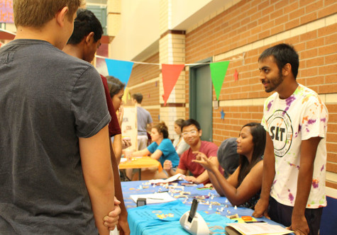 Representatives of the Visionaries and Inventors of Tomorrow club tell seniors about the science-based organization.