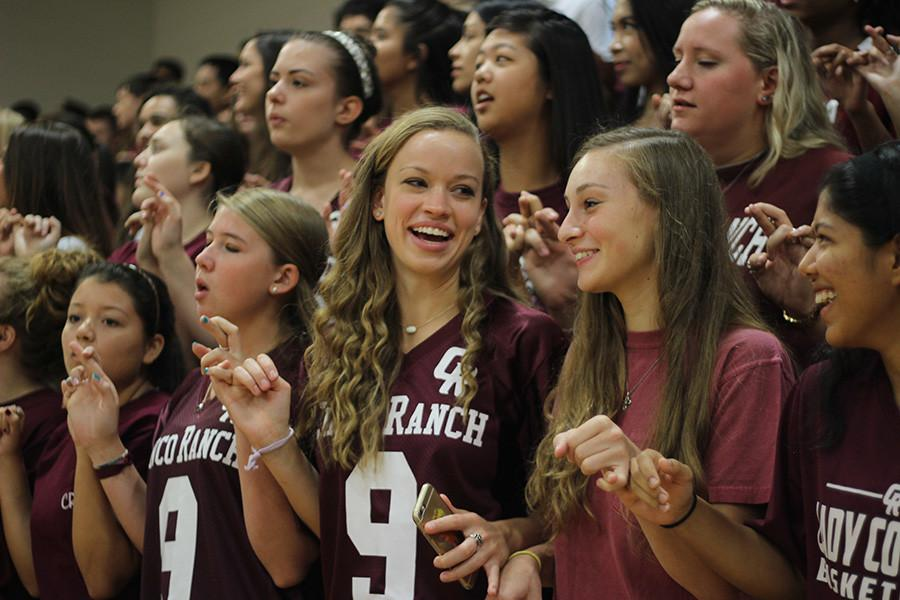Students celebrate with the school alma mater during Friday's pep rallies.