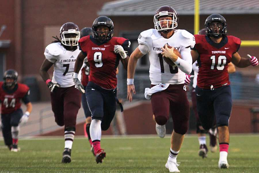 Senior QB Russell Morrison  leaves Tompkins defenders behind as he streaks for one of his two 50+ yard TD runs in the first half Thursday night at Rhodes Stadium. Morrison has gained over 1400 yards of total offense in the first six games of the season. Cinco improves to 6-0 on the year with a 3-0 district record.