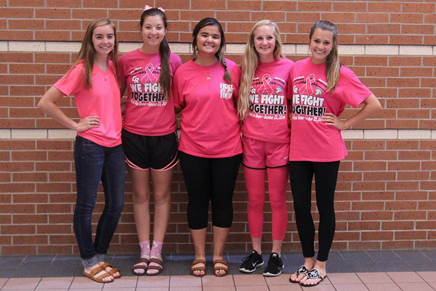Band+members+Julia+Culp%2C+Kyra+Hogan%2C+Samantha+Smith%2C+Abby+Draut%2C+and+Rachel+Schierman+promoted+theme+day+and+proudly+dressed+in+pink+to+show+their+support+for+cancer+and+to+wish+the+varsity+football+team+luck+on+its++match+against+Tompkins.