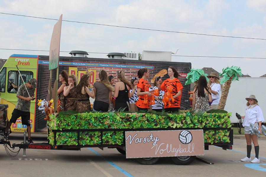 The girls' varsity volleyball team dressed its float to a jungle theme, one of the most decorative floats present at the parade.