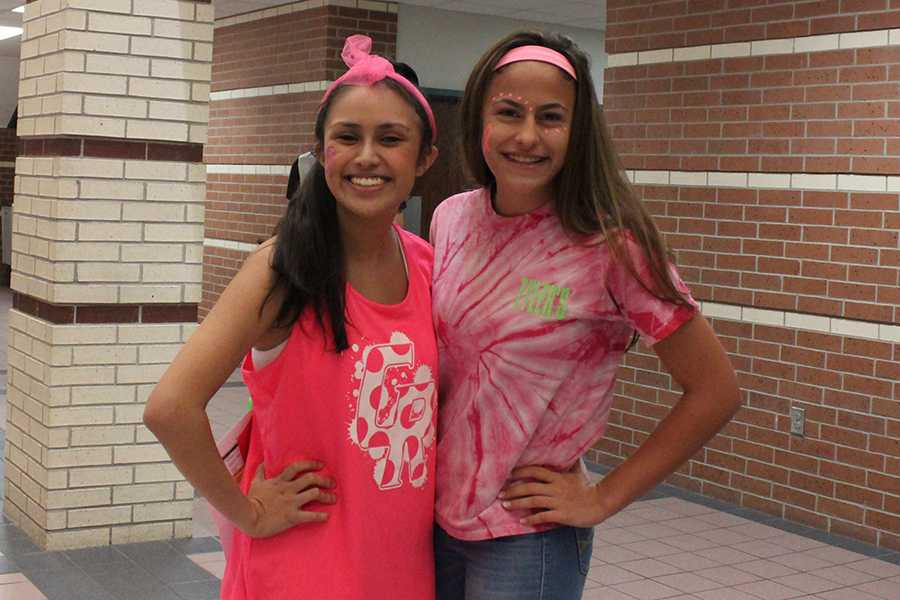 Senior+Angela+Salguero+and+freshman+Isabella+Machado+decked+out+in+pink+attire+along+with+pink+face+paint+for+theme+day.