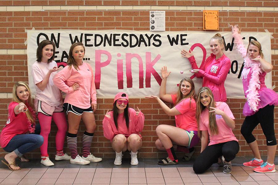 Senior girls posed next to the theme day poster to give a shout out for their support for cancer patients and their families.