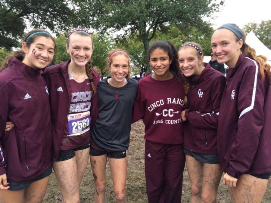 Varsity runners smile for a picture after their State meet at Old Setter's park in Round Rock, Texas. All of the girls took part in the 5,000 meter run, where 152 people competed altogether. (Reagan Bunch)