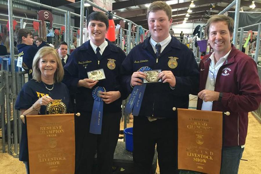 FFA members  Senior Bo Barrilleaux  and freshman Jaxon Maikoetter celebrate a CRHS sweep of the Grand Champion and Reserve Grand Champion hogs during day one of the KISD FFA Livestock Show Feb. 18. Helping congratulate them are Associate Principal Patti Smith and Principal James Cross.  FFA sponsors John Ford, Dean Fuchs, Erynn Tryptow and Amanda Kacal prepared this year's chapter members for the seven contests held this weekend at the KISD L.D. Robinson Pavilion.