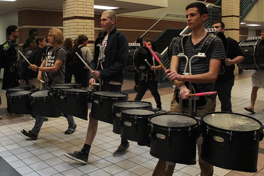 The tenor drums join the sendoff, and play a beat for onlookers.