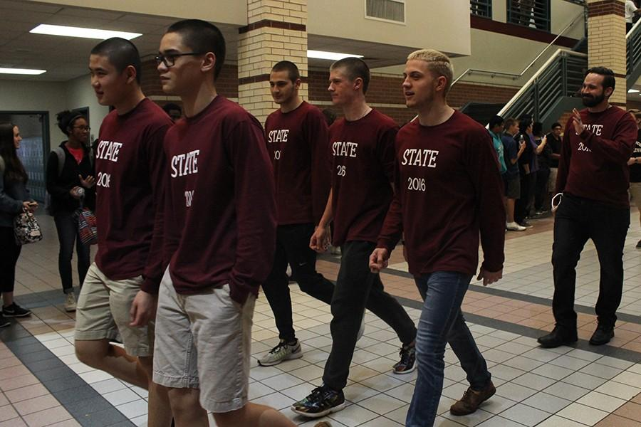 Swimmers on their way to state wear maroon shirts showing where they are headed.