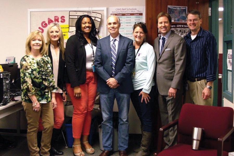 CRHS Teacher of the Year, Mike Marrie (center) is awarded the campus distinction by Associate Principal Patti Smith,  Instructional Coaches Erica Robinson,  Jacque Ekeoba, Kim Johnston, Principal James Cross and CTE instructor John Bryan.