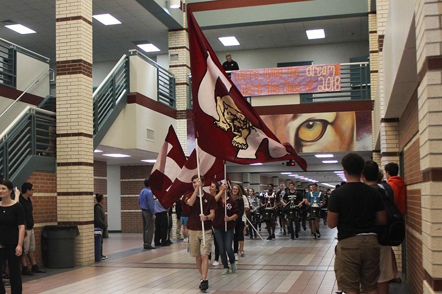 Ranch Hands lead the sendoff through the hallway as students crowd to see the swimmers and wrestlers who are on their way to state.  The sendoff occurred on Feb. 18.