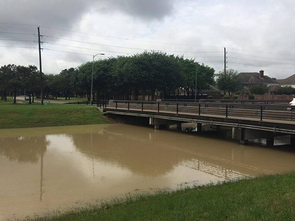 Waters almost fill Buffalo Bayou underneath a bridge on Westheimer Parkway. Many students use the bridge to get to school.