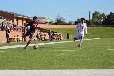 Senior Chance Duffy prepares to cross the ball to the strikers in an attempt to score and break the tie.