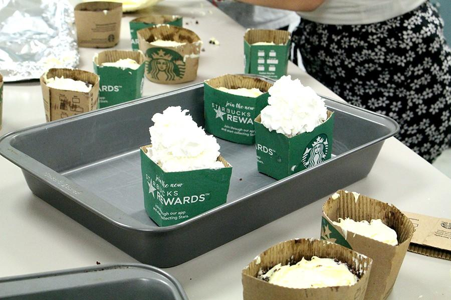 Competitors pile whipped cream on top of their Starbucks inspired treats in a bid to make them more resemble the chains iconic frappuccino.