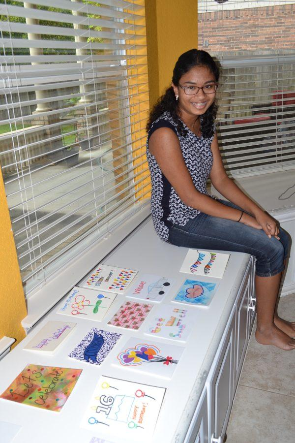 Eilisha and some of her homemade cards, including several made by Special Needs students and adults at Everyday Opportunities.