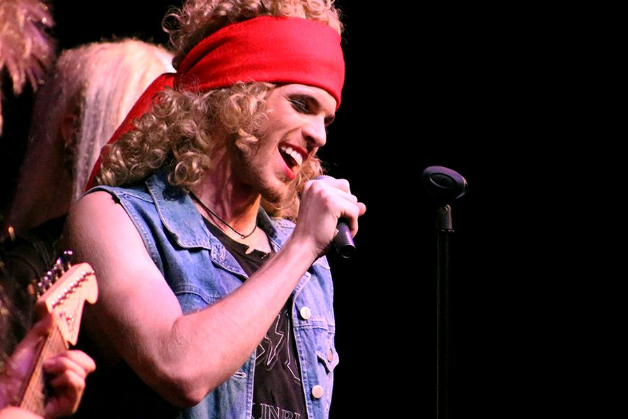 Drew Boley played by Senior Dylan Boyd sings one of his many songs as he tries to win the affections of  aspiring actress Sherrie Christian.