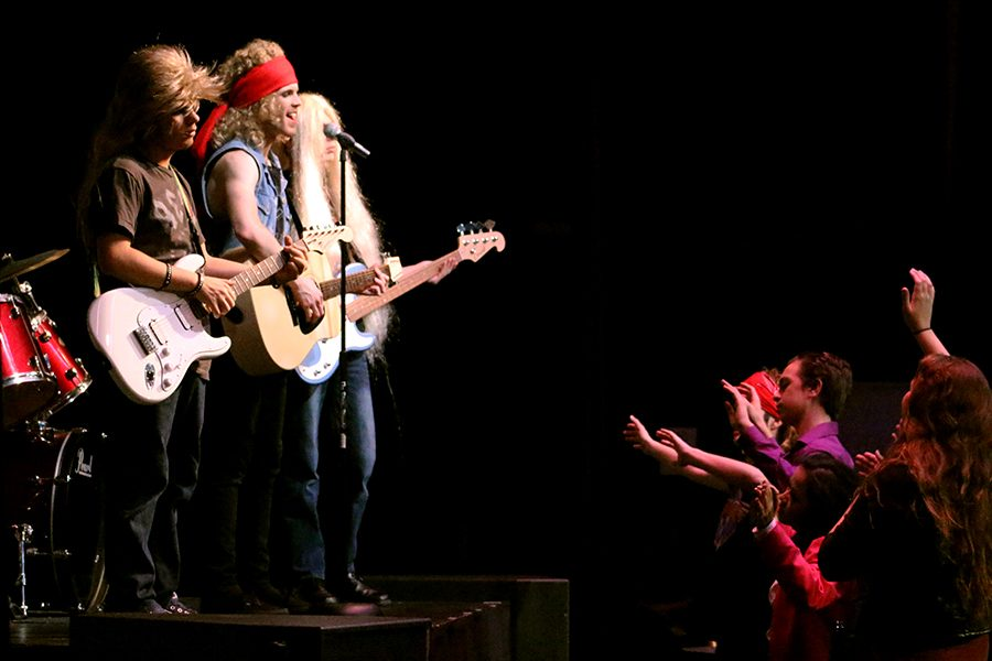 Drew Boley played by senior Dylan Boyd opens for Stacee Jaxx (Stewart), a rockstar about to split from his original band at the Wednesday dress rehearsal. The two end up as love rivals, both fighting over the attention of Sherrie Christian (Sadler).