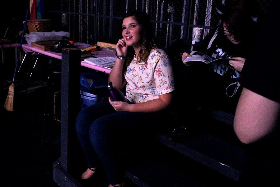Sherrie Christian played by junior Skyler Sadler waits in the wings for her cue at dress rehearsal. Christian moved to California from the Midwest to become an actress and instantly hits it off with Boley (Boyd).