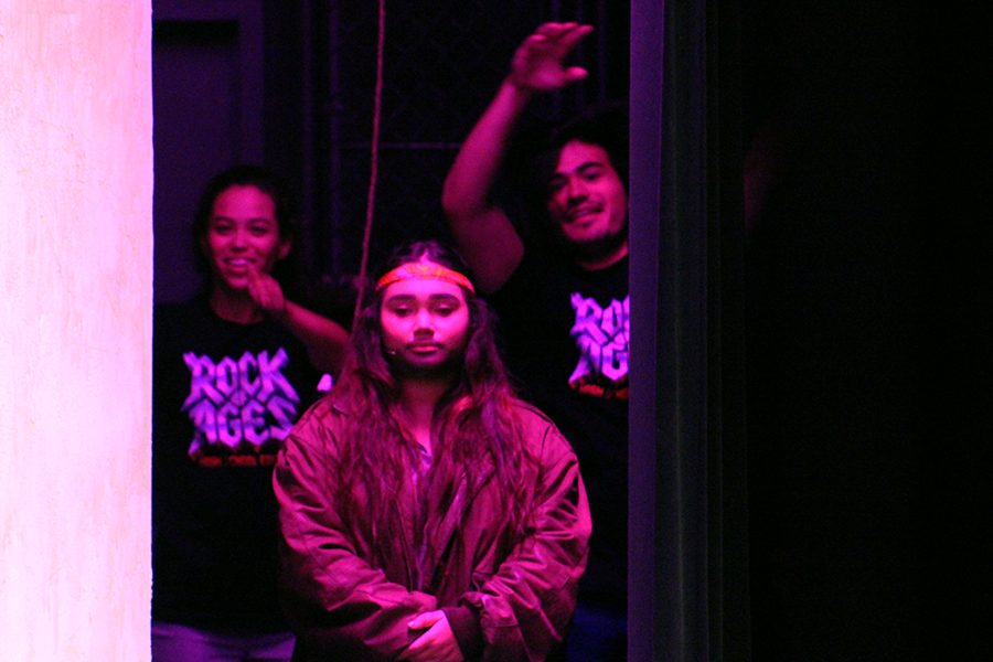 Junior Sydney Lavigne, co-crew head of set and senior Jose Zoghbi, Student Technical Director, dab as junior Rachel Regner, who plays Dennis Dupree, owner of the Bourbon Room, prepares to go onstage. Crew often dance along to the rockin music of the 80s showcased in this production.