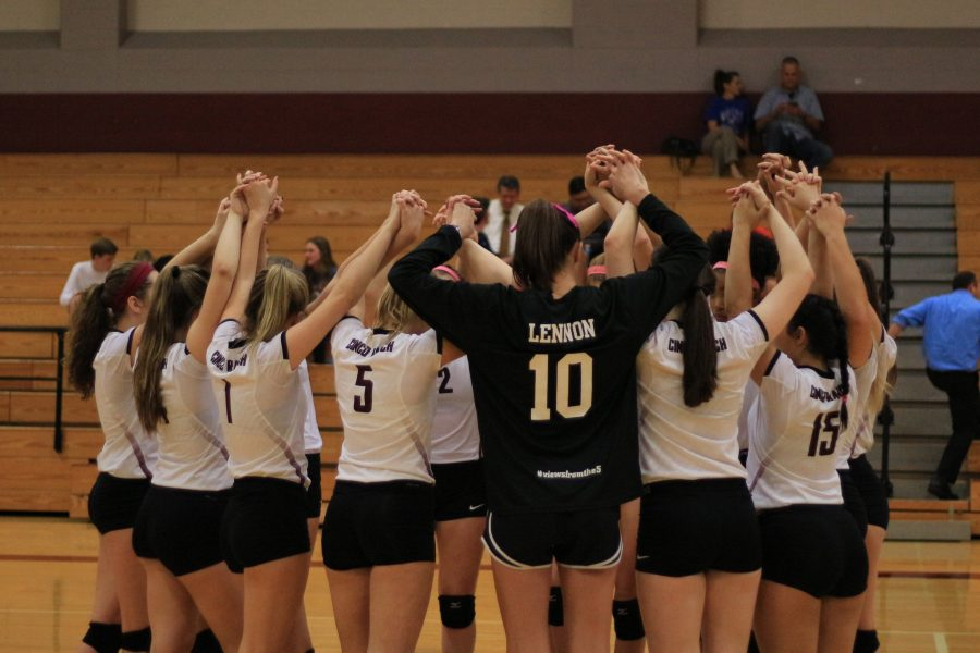 The varsity team gathers hand in hand before their game on Oct. 11, 2016. Cinco walked out with a 3-0 win against Katy Taylor.
