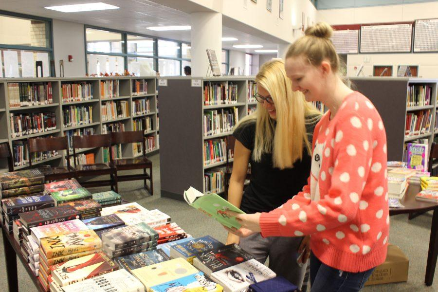 Juniors Kyra Dyer and Sarah Christy view books on sale. The book fair was held on Tuesday and Wednesday.