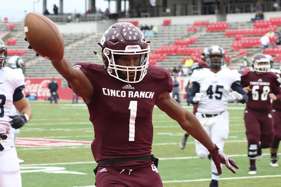 Senior WR Greg Williams hauls in a 49-yard TD pass from James Klingler just before halftime in the Region III Final at TDECU Stadium Saturday. Cinco beats Cy-Ridge 34-17 to advance to the UIL State semi-finals.