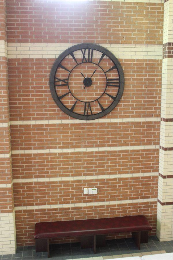 A new clock adorns the wall outside the 9th grade  office. Student Council also contributed to the new furniture items.