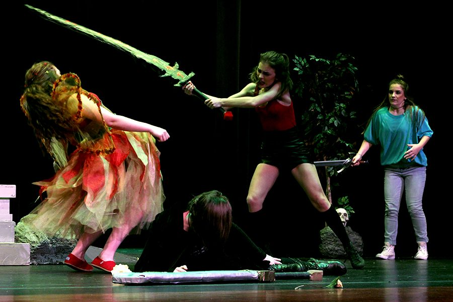 Protagonist Agnes Evans (Gunder) watches from the sidelines as Lilith, played by junior Elyssabeth Pratt, defends Tilly Evans, played by junior Kaia Helmer, her game girlfriend, from the homicidal fairie Farrah, played by junior Avery Connor. In the play, Agnes (Gunder) enters a world her sister created in Dungeons and Dragons before her family died in a car crash. Because it's an alternate universe they play in, her sister remains alive and this allows her to better understand Tilly ( Helmer).