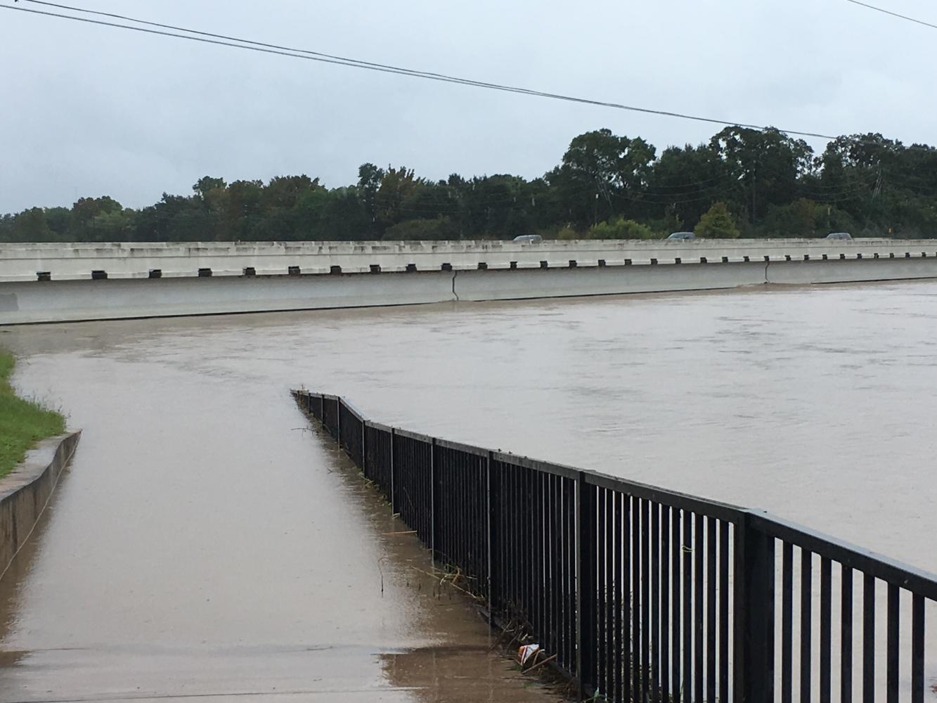Water in Buffalo Bayou reaches the bottom of Highway 99 on Sunday Morning, Aug. 27.