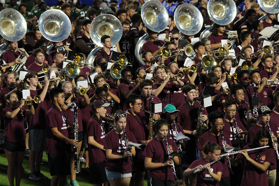 Band members perform at the opening ceremony of Legacy Stadium.